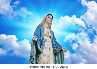 Our lady of grace virgin Mary with Bright Blue Sky and beautiful clouds with abstract colored background and wallpaper.