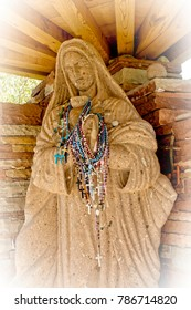 Our Lady of Guadalupe statue at Chimayo Santaurio in Chimayo, New Mexico with vinette