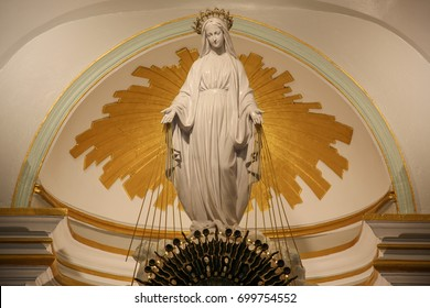 Our lady of miraculous medal statue