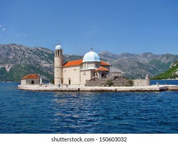 Our Lady of the Rock island and Church in Perast on shore of Boka Kotor bay (Boka Kotorska), Montenegro