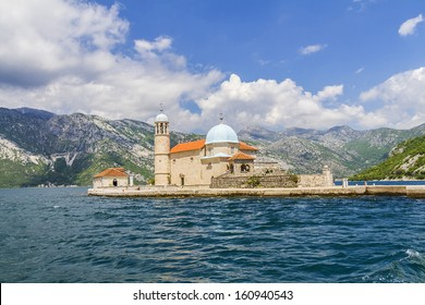 Our Lady of the Rock island and Church in Perast on shore of Boka Kotor bay (Boka Kotorska), Montenegro, Europe. Kotor Bay is a UNESCO World Heritage Site.