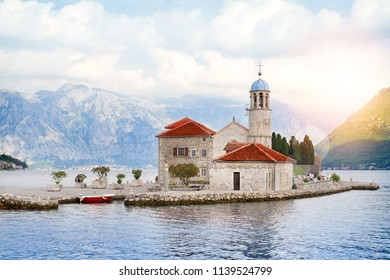Our Lady of the Rock and St.George Island in Perast on shore of Boka Kotor bay, Adriatic Sea, Montenegro. Picturesque sea and mountain scenery