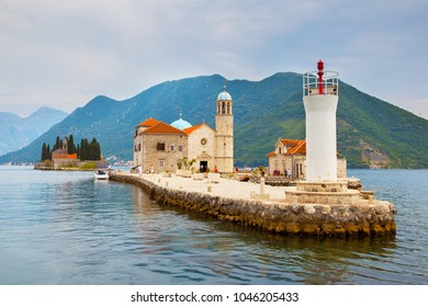 Our Lady of the Rocks church and lighthouse on small island in the Kotor Bay near Perast town, Montenegro