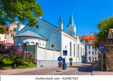 Our Lady of Sorrow catholic church and medieval street in old Riga city, Latvia.