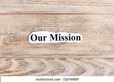 Our Mission text on paper. Word Our Mission on torn paper. Concept Image.