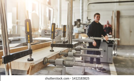 Our worry is quality not amount. Carpenter work. Gluing the wooden structure. Joiner clamps. Wooden construction under the press. Wooden products to order.
