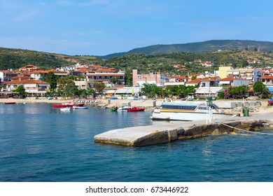 Ouranoupolis, Greece - June 1, 2015: Ouranoupolis panorama town and houses view, harbor, boats, Athos, Greece. View from the Aegean sea