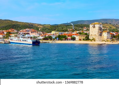 Ouranoupolis harbor, ferry boat and ancient Tower of Ouranoupoli , Athos, Greece. View from the Aegean sea