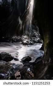 Ouray Box Canyon Waterfall sun light shining on Quartzite walls