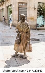 OURENSE, SPAIN - JUN 13, 2017: Street sculpture of milk trader