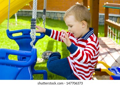our-year-old kid on a swing