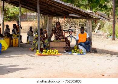 OUSSOUYE, SENEGAL - APR 30, 2017: Unidentified Senegalese woman sells tomatoes in Oussouye, a town in Senegal
