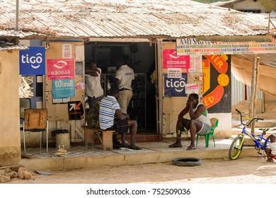 OUSSOUYE, SENEGAL - APR 30, 2017: Unidentified Senegalese people gather near the shop in Oussouye, a town in Senegal