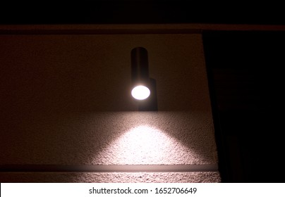 an out door lamp light on the wall