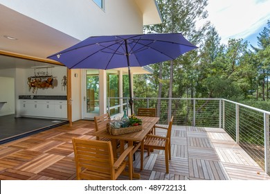 Out door patio connecting to kitchen surrounded by trees
