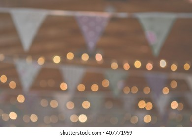 out of focus background of bunting and fairy lights at wedding party or event