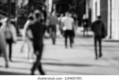 Out of focus background with people crossing street.