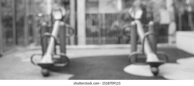 Out of focus black and white tone of empty seesaw in kindergarten in child abuse concept.