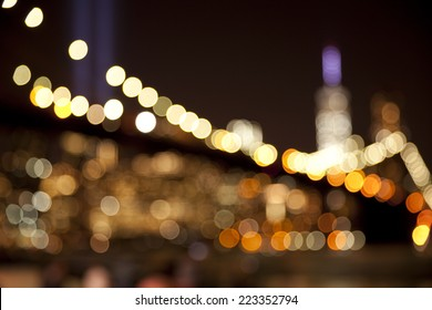 Out of focus Bokeh lights background of Brooklyn Bridge with the tribute in light at the back in New York City at September 11.