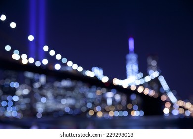 Out of focus bokeh lights of Brooklyn Bridge with the tribute in lights at September 11.  Great for backdrop or background.