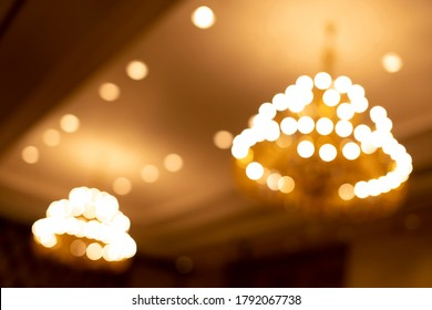 out of focus Ceiling lamp in hotel Blurred background