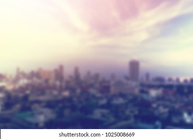 out of focus city and dramatic skyscape blurred background