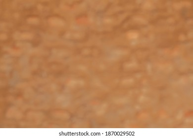 Out of focus ecological cob wall rural construction pattern texture for background
