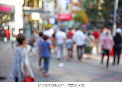 out of focus people walking - blurred background concept