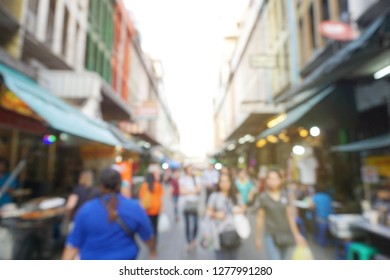 Out of focus picture of a crowd of people walking in the street of Thailand.