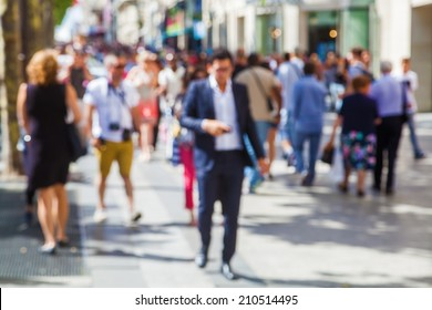 out of focus picture of a crowd of people walking in the city