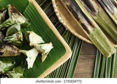 Out of focus Satar or Sata is a traditional dish from the Malaysian state of Terengganu, consisting of spiced fish meat wrapped in banana leaves and cooked on a grill.