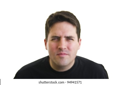 Out of focus, short sighted man squinting