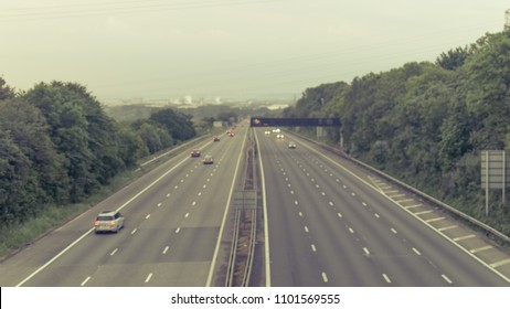 Out of focus slow traffic on M5 Motorway B, Captured in Clapton-in-Gordano, England - split toning