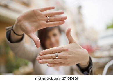 Out of focus woman and framing symbol in natural light outdoors image - Shutterstock ID 274840136