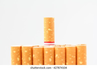 out standing cigarette with a brown filter