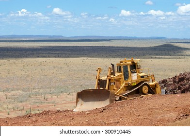 OUTBACK, AUSTRALIA - January 14, 2011: Heavy Caterpillar D9N bulldozer moving earth for iron ore exploration drilling