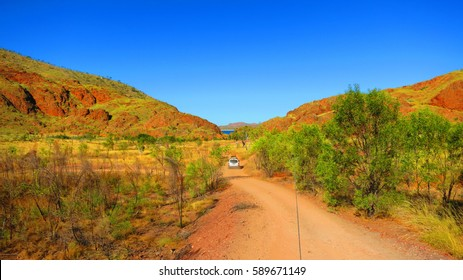 Outback australia - road trip driving 4x4 4 wheel drive jeep off road through dirt track to camping spot near Lake Argyle - Ord River Irrigation Scheme. East Kimberley town of Kununurra