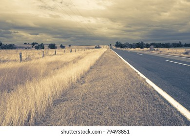 outback fields and road with wind in dry grass