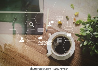 Outbound marketing business virtual dashboard with Offline or interruption marketing.Coffee cup and Digital table dock smart keyboard,vase flower herbs,stylus pen on wooden table,filter effect