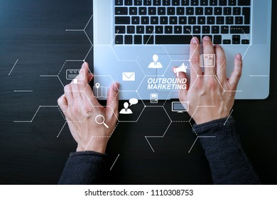 Outbound marketing business virtual dashboard with Offline or interruption marketing.cyber security internet and networking concept.Businessman hand working with laptop computer