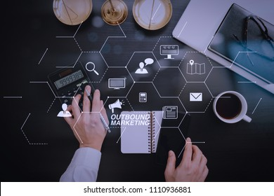 Outbound marketing business virtual dashboard with Offline or interruption marketing.justice and law concept.businessman or lawyer or accountant working on accounts using a calculator
