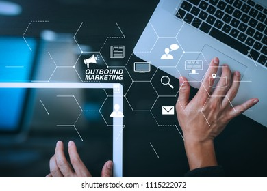 Outbound marketing business virtual dashboard with Offline or interruption marketing.cyber security internet and networking concept.Businessman hand working with  laptop computer and digital tablet.