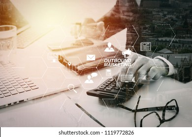 Outbound marketing business virtual dashboard with Offline or interruption marketing.businessman hand working with finances about cost and calculater and latop with mobile phone  in modern office.