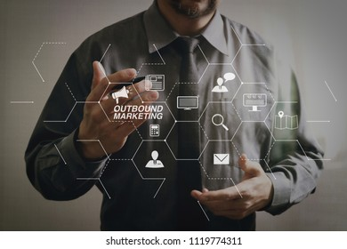 Outbound marketing business virtual dashboard with Offline or interruption marketing.success businessman open his hand,working touch screen computer,front view,filter effect