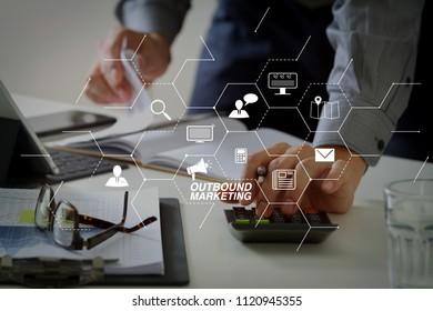 Outbound marketing business virtual dashboard with Offline or interruption marketing.businessman hand working with finances about cost and calculator and latop with mobile phone on withe desk.
