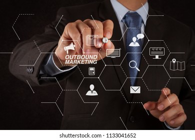 Outbound marketing business virtual dashboard with Offline or interruption marketing.businessman hand writing in the whiteboard or virtual screen