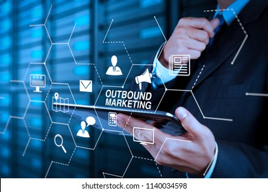 Outbound marketing business virtual dashboard with Offline or interruption marketing.businessman hand using tablet computer and server room background