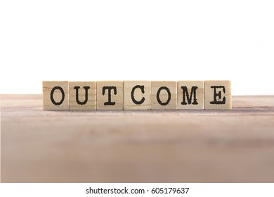 Outcome Word Written In Wooden Cube