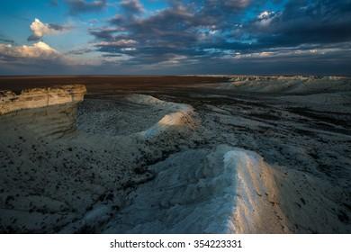 Outcrops of chalk on the background dark blue sky. Kazakhstan, the Ustyurt plateau, Akkergeshen - unique Cretaceous outcrops witnesses of the Cretaceous period.