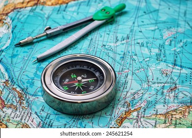 outdated compass sailor on a topographic map.Copy space